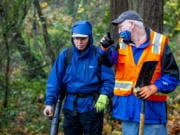 Dale Meier, left, listens to instructions from event organizer Jeff Wills on Saturday afternoon on the Interstate 205 bike path off of Highway 14. Several people assisted in clearing the bike path of leaves, garbage and roots.