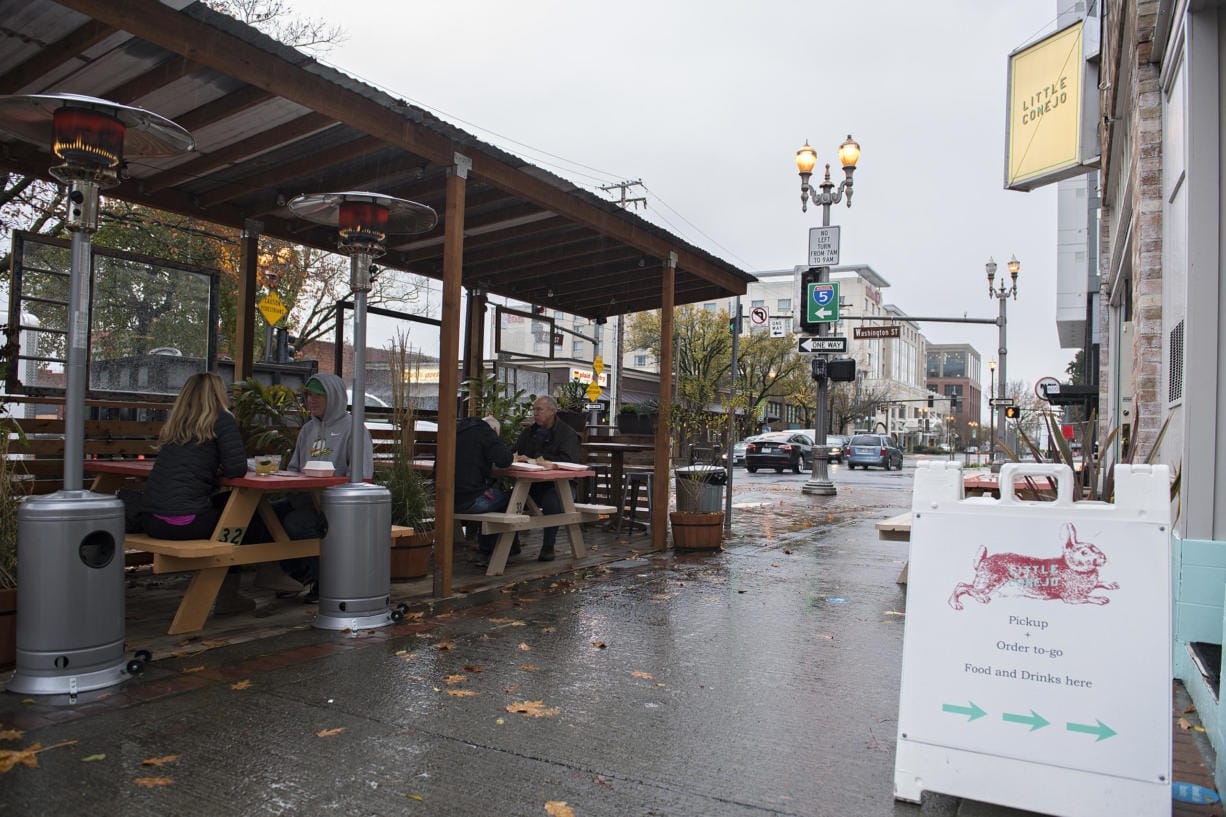 A roof protects customers in Little Conejo's outdoor dining space in downtown Vancouver on Wednesday afternoon.