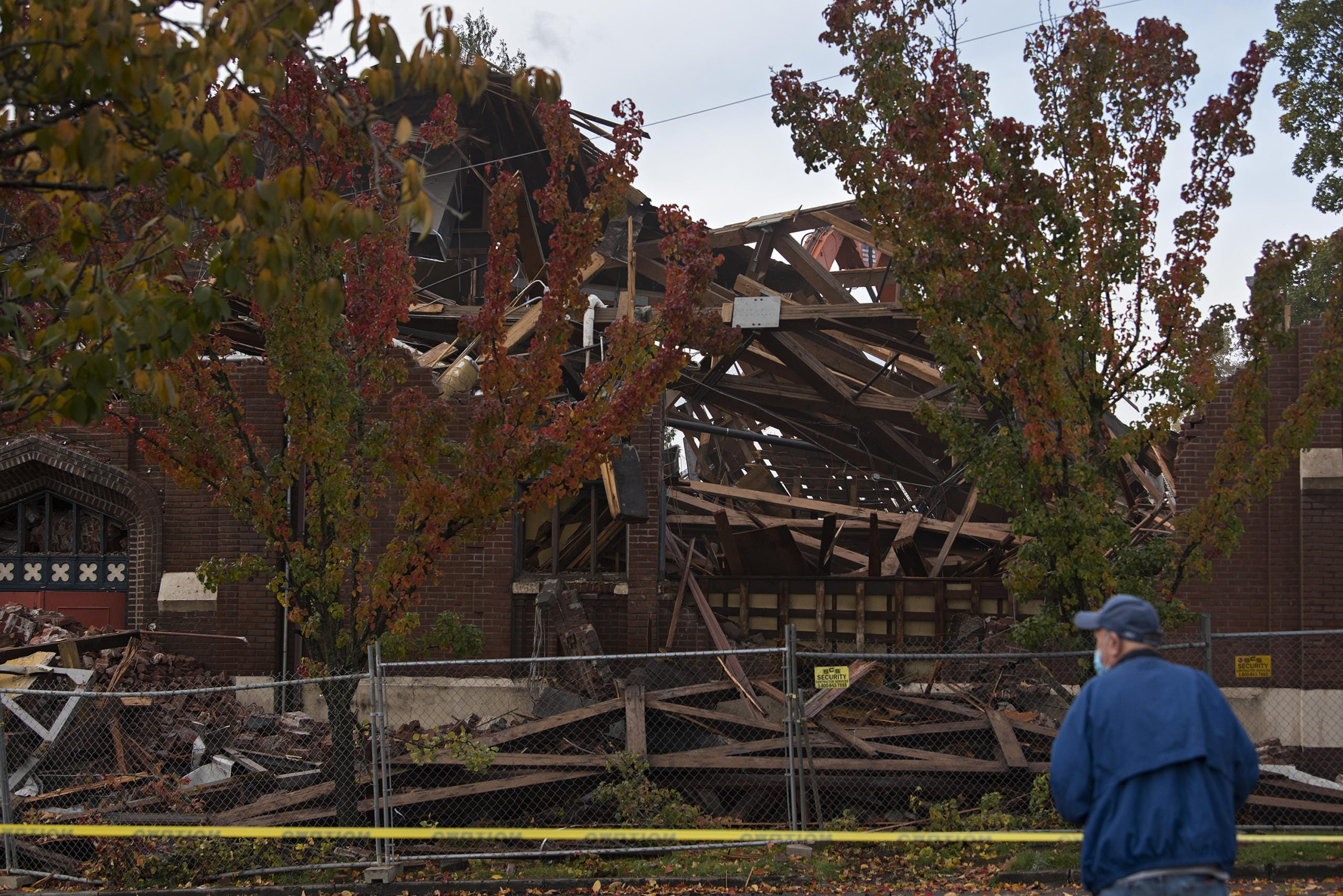 """Gary Dunne of Vancouver pauses to take photos during the demolition of the former downtown location of New Heights Church on Friday morning, Nov. 13, 2020. Dunne was also joined by his wife, Marlene, who he married at the church in 1959. The couple raised three daughters there. """"It just felt like home,"""" Marlene Dunne said."""