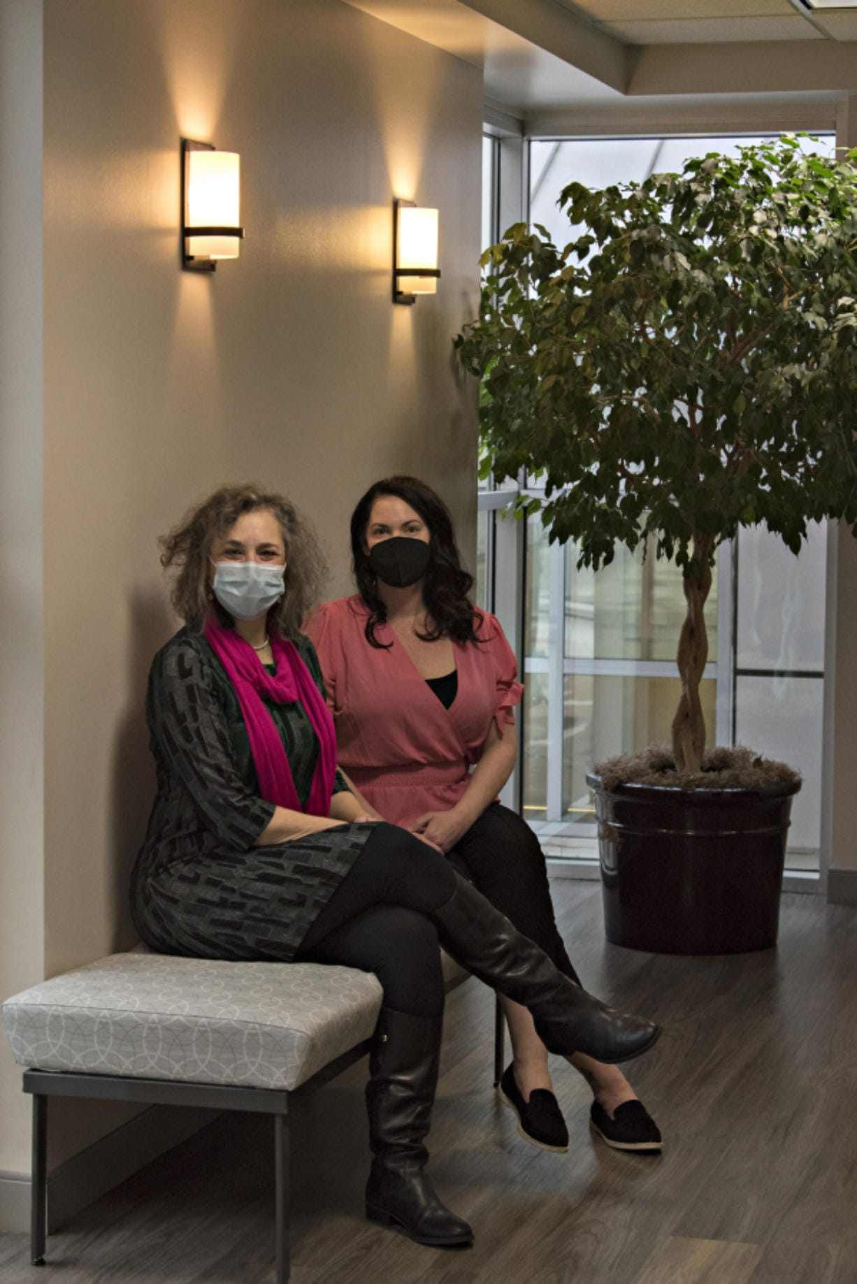 Susan Stearns, left, CEO of the Pink Lemonade Project, pauses for a portrait with Melissa Mohr, practice manager at Dr. Allen Gabriel's office in Vancouver. Stearns and Mohr have worked together on Holiday Glow, which will provide financial assistance to breast cancer patients and those in recovery this holiday season.