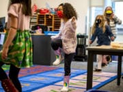 Jade Westbrooks, 5, stomps her feet as part of a counting exercise in Molly Davenport's kindergarten class Tuesday morning at Marshall Elementary in Vancouver. Kindergartners recently began in-person learning in Vancouver Public Schools.