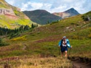 Elisabeth Tizekker Jeff Garmire runs along the Colorado Trail in August. A camera crew followed him during part of his 500-mile journey and captured enough footage to create a documentary. The trailer is coming next month, he said, and he plans on submitting it to some film festivals.