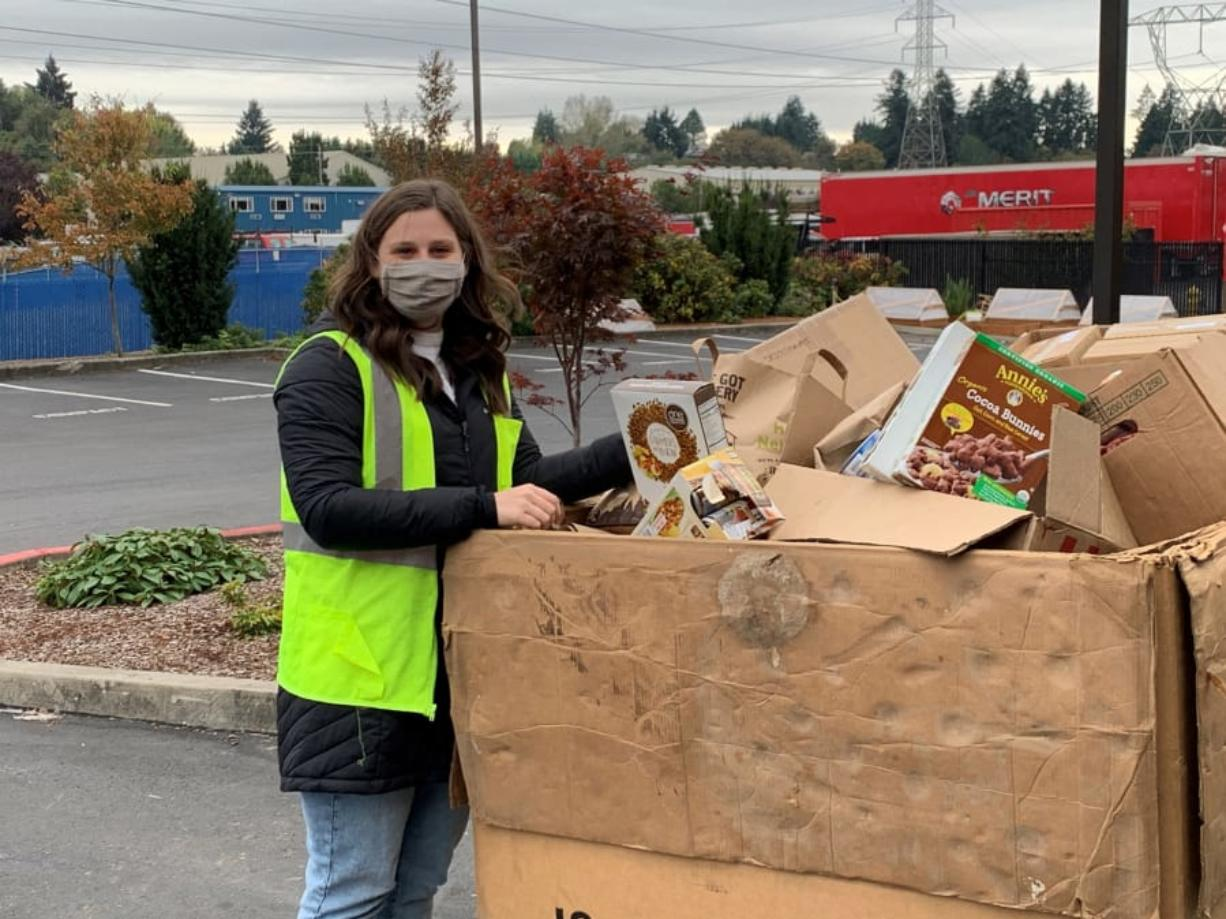 Ali Laskowski, events coordinator at the Clark County Food Bank, puts food into a tote box. The food bank will be one of eight drop-off sites for this year's Walk & Knock food drive on Dec. 5.