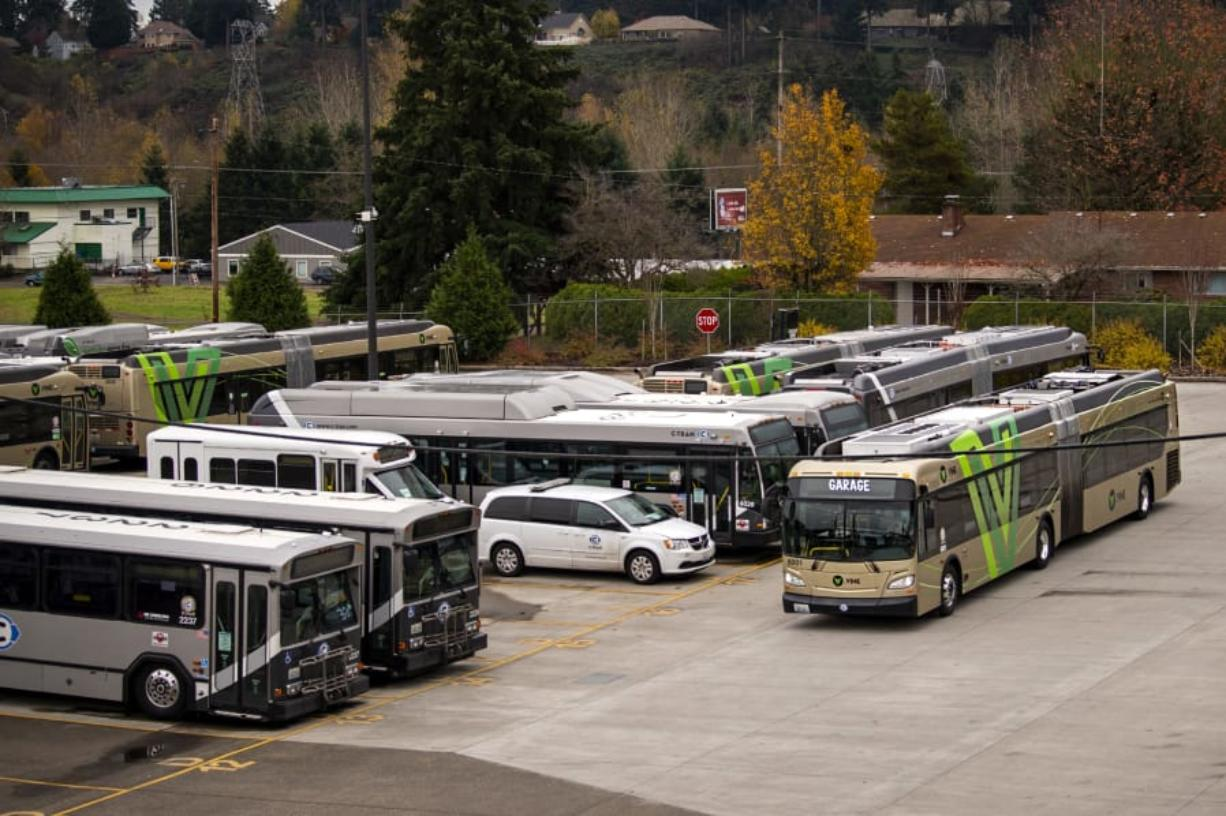 A 60-foot Vine bus drives through the lot at the C-Tran bus yard in Vancouver. C-Tran's first bus rapid transit line debuted on Fourth Plain Boulevard in 2017, and construction is slated to start next year on a second line along Mill Plain Boulevard.