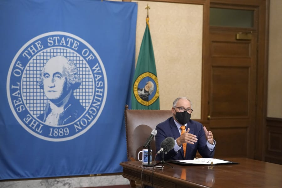 Washington Gov. Jay Inslee announced new statewide COVID-19 restrictions on Sunday. (Ted S.