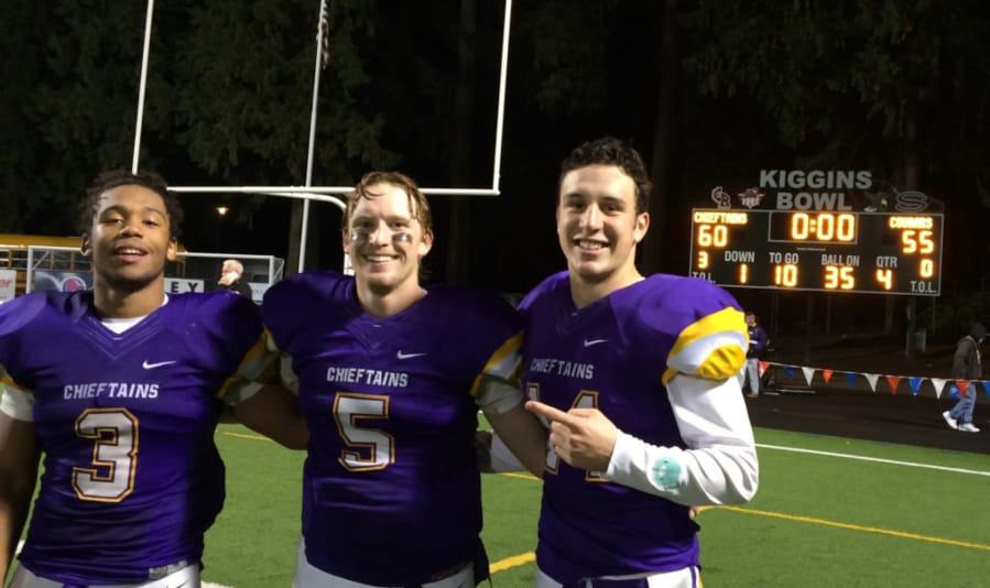 Columbia River's Travon Santiago (3), Garrett McKee (5) and Alex McGarry helped the Chieftains light up the scoreboard Friday, Nov. 5, 2015, in Columbia River's playoff win over Capital.
