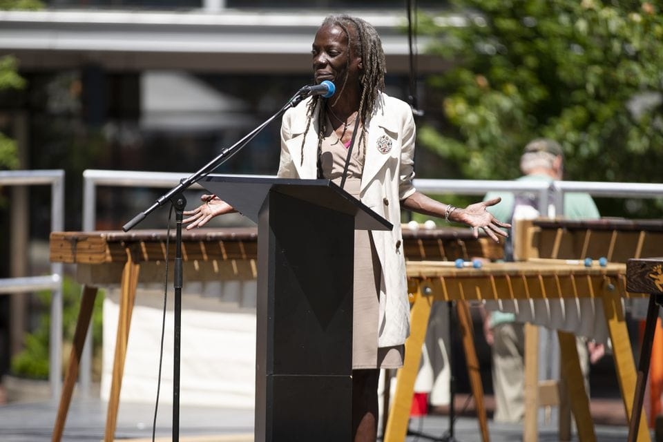 City of Portland Commissioner Jo Ann Hardesty spoke as several hundred people gathered in Director Park in Portland on Tuesday, June 4, 2019, in support of a group of young people who have filed a federal lawsuit asserting a constitutional right to a climate system capable of sustaining human life. Supporters watched videos, held signs and viewed a live stream of a hearing in the case before the 9th U.S. Circuit Court of Appeals in Portland.