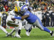 Green Bay quarterback Aaron Rodgers (12) is sacked by Detroit defensive tackle Damon 'Snacks' Harrison in a 2019 game. Harrison is set to make his debut with the Seattle Seahawks on Sunday against the Los Angeles Rams.