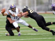 After a move to the defensive line as a junior, Woodland High grad Tristan Thomas (24) has flourished at Pacific Luthern. He appeared in all nine games last season, tallied 52 tackles, 5.5 sacks and was named an all-Northwest Conference honorable mention.