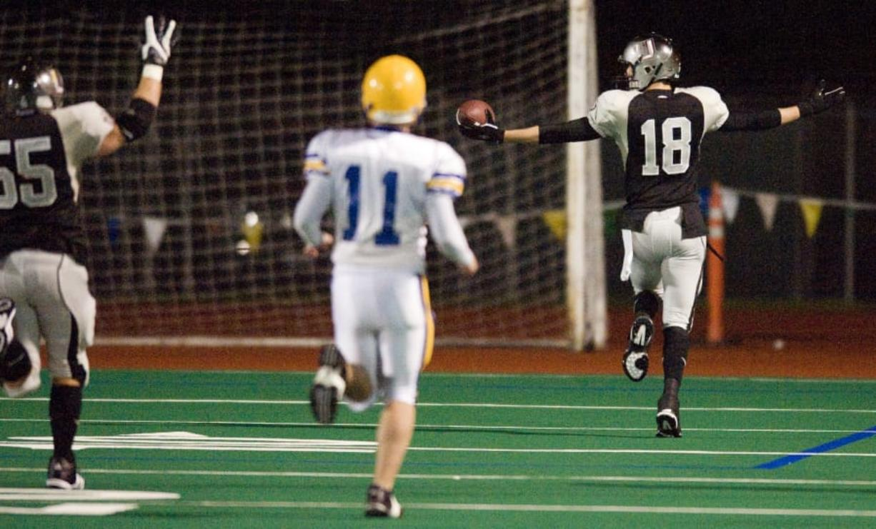 Union's Mitch Saylor (18) returns a blocked Ferndale field goal attempt for the winning touchdown with seconds remaining in the game to break a 14-14 tie, Saturday, November 22, 2008. Union won 21-14.