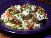 Middle Eastern Meatballs With Herbed Couscous (Linda Gassenheimer/TNS)
