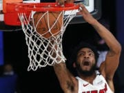 Miami Heat's Derrick Jones Jr. dunks against the Oklahoma City Thunder during the second half of an NBA basketball game Wednesday, Aug. 12, 2020, in Lake Buena Vista, Fla. (Kevin C.