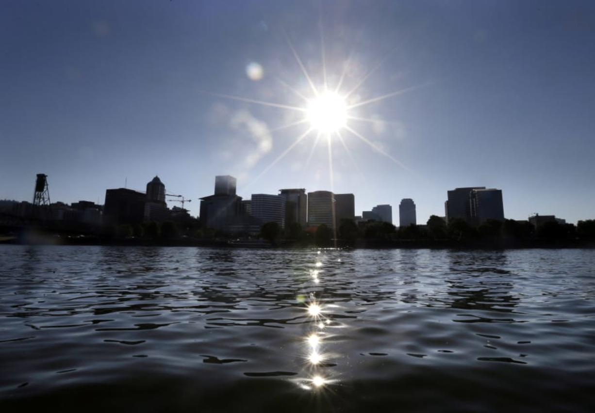 The afternoon sun sparkles on the Willamette River in downtown Portland in July 2017.