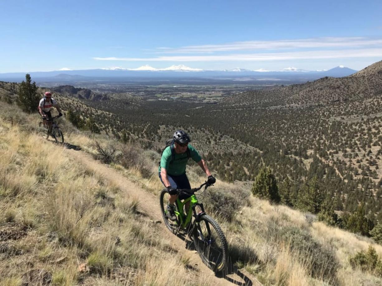 Two mountain bikers ride the Gray Butte Trail near Smith Rock State Park.
