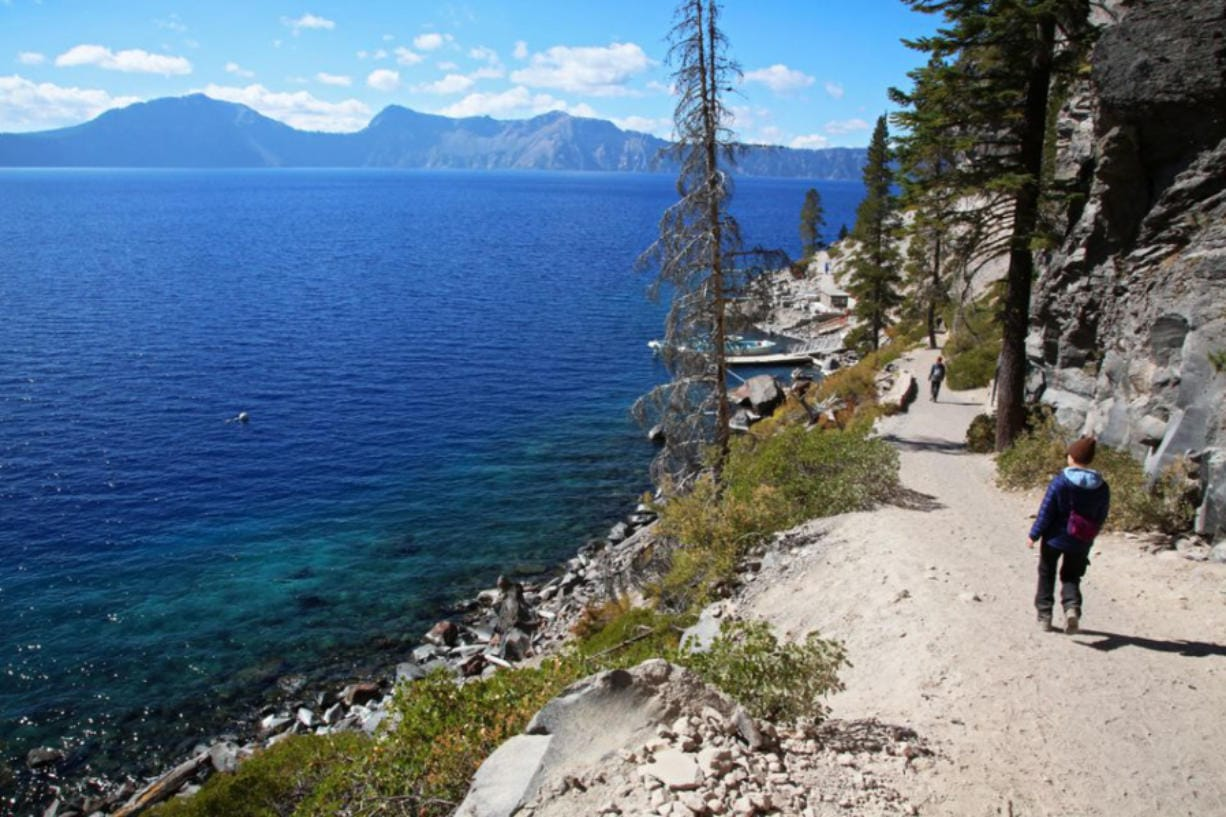 Visitors hike down the trail to Cleetwood Cove at Crater Lake National Park in 2018.