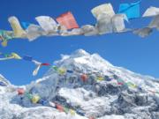Prayer flags flutter in the breeze at Mount Everest.