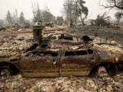 A neighborhood destroyed by fire is seen as wildfires devastate the region, Friday, Sept. 11, 2020 in Talent, Ore.