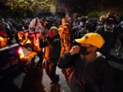 People march on the night of the election, Tuesday, Nov. 3, 2020, in Portland, Ore.