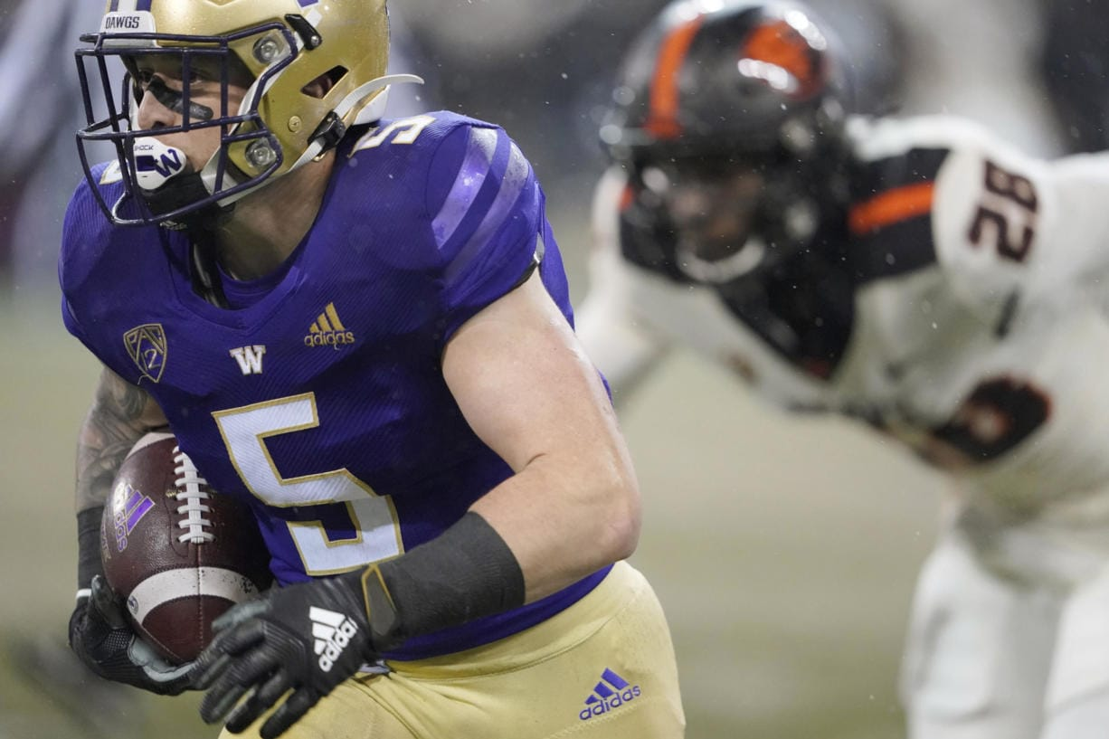 Washington running back Sean McGrew (5) runs for a touchdown against Oregon State during the first half of an NCAA college football game, Saturday, Nov. 14, 2020, in Seattle. (AP Photo/Ted S.