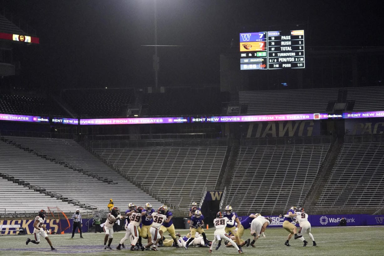 Washington running back Sean McGrew (5) rushes against Oregon State in a Husky Stadium void of fans during the coronavirus pandemic, during the first half of an NCAA college football game Saturday, Nov. 14, 2020, in Seattle. (AP Photo/Ted S.