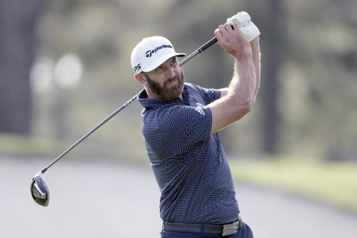 Dustin Johnson tees off on the third hole during the final round of the Masters golf tournament Sunday, Nov. 15, 2020, in Augusta, Ga.