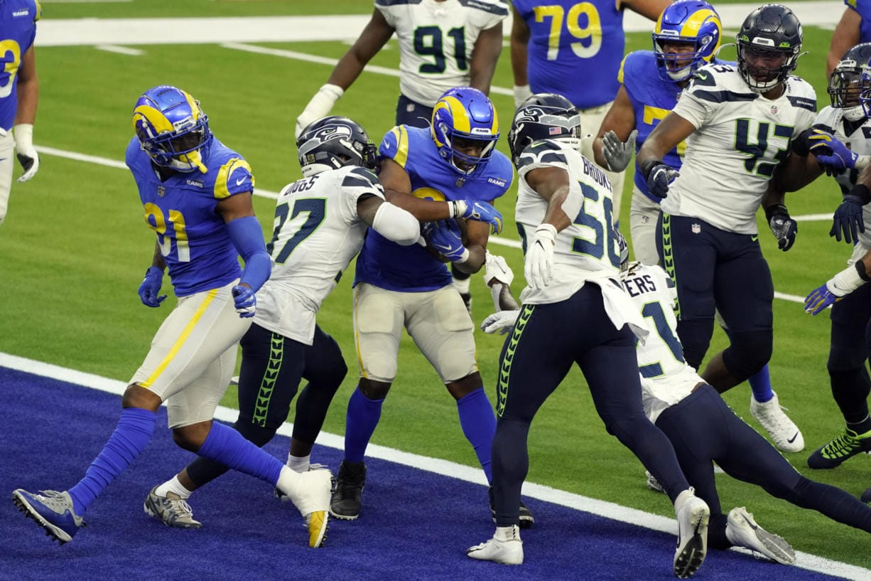 Los Angeles Rams running back Malcolm Brown, center, scores a rushing touchdown against the Seattle Seahawks during the second half of an NFL football game Sunday, Nov. 15, 2020, in Inglewood, Calif.