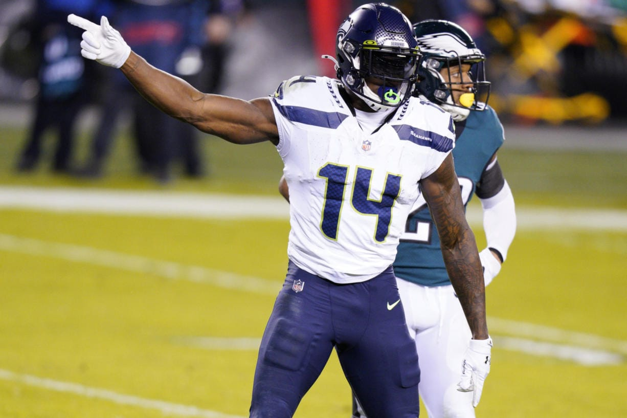 Seattle Seahawks' DK Metcalf reacts after a first down catch during the first half of an NFL football game against the Philadelphia Eagles, Monday, Nov. 30, 2020, in Philadelphia.