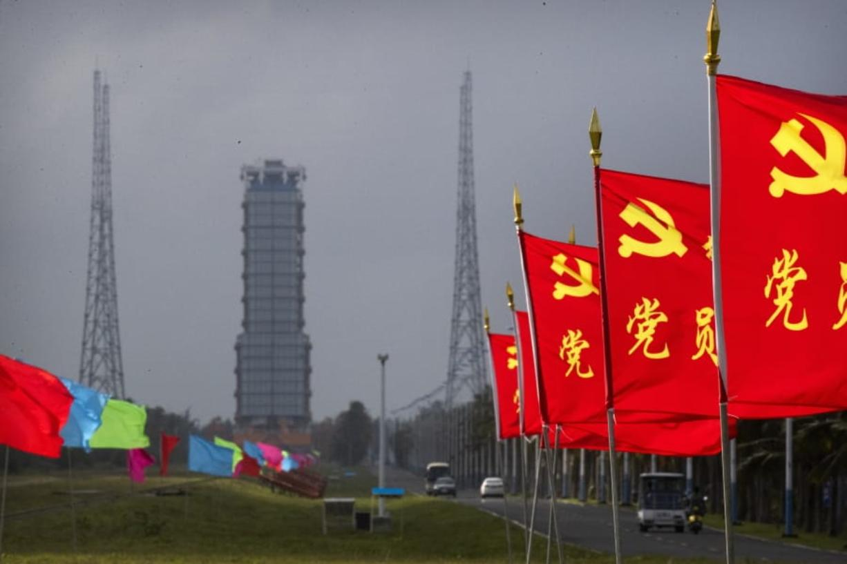 Flags with the logo of the Communist Party of China fly in the breeze near a launch pad at the Wenchang Space Launch Site in Wenchang in southern China's Hainan province, Monday, Nov. 23, 2020. Chinese technicians were making final preparations Monday for a mission to bring back material from the moon's surface for the first time in nearly half a century -- an undertaking that could boost human understanding of the moon and of the solar system more generally.