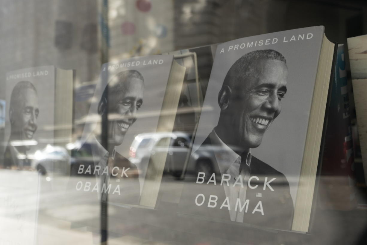 """""""A Promised Land"""" by former President Barack Obama is displayed in the window of a New York bookstore, Wednesday, Nov. 18, 2020."""