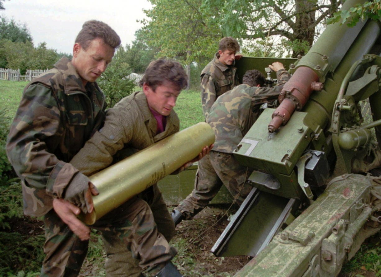 FILE - In this Oct. 4, 1995. file photo, Bosnian government soldiers load a 130mm howitzer with shells at their artillery position near the Serb-held town of Sanski Most, some 60 miles northwest of Sarajevo, Bosnia. While it brought an end to the fighting, the Dayton peace agreement baked in the ethnic divisions, establishing a complicated and fragmented state structure with two semi-autonomous entities, Serb-run Republika Srpska and a Federation shared by Bosniak and Croats, linked by weak joint institutions.