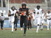 Oregon State running back Jermar Jefferson (6) runs 75-yards to score a touchdown on the first play of an NCAA college football game against California in Corvallis, Ore., Saturday, Nov. 21, 2020.