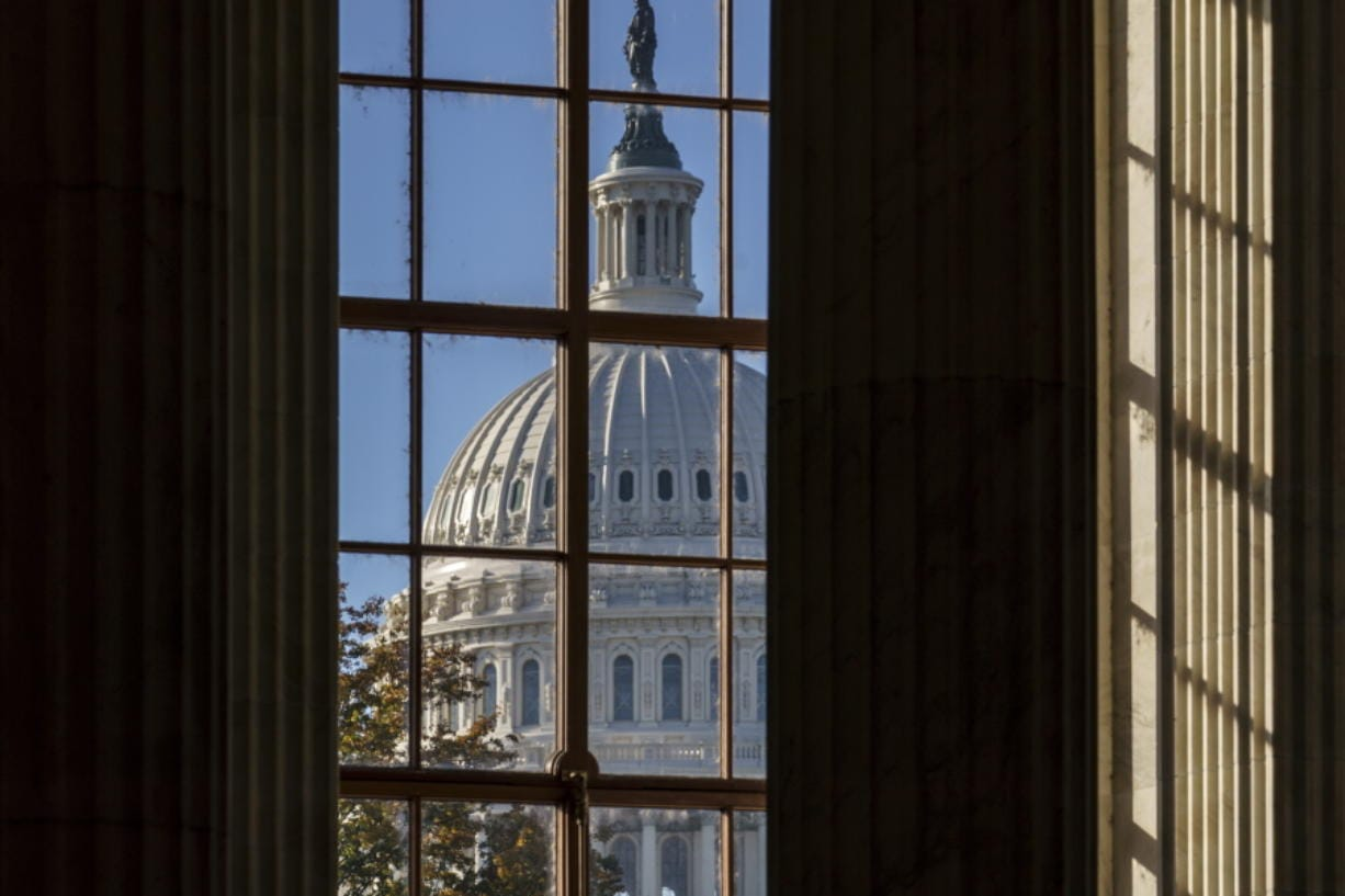 FILE - In this Nov. 10, 2020, file photo the morning sun illuminates the rotunda of the Russell Senate Office Building on Capitol Hill in Washington. After months of shadowboxing amid a tense and toxic campaign, Capitol Hill's main players are returning to Washington for one final, perhaps futile, attempt at deal making on a challenging menu of year-end business. (AP Photo/J.
