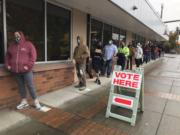 A line stretches around the block at the Clark County Elections Office on Tuesday after as people register and vote.