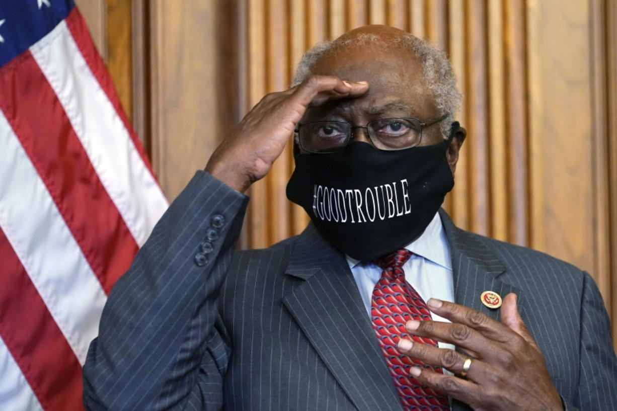 FILE - In this Sept. 17, 2020, file photo, House Majority Whip James Clyburn of South Carolina shields his eyes from a television light to look at a reporter asking a question during a news conference with House Speaker Nancy Pelosi on Capitol Hill. Clyburn and other Democrats blamed rhetoric about defunding local police departments for the party's surprise loss of seats in the House.