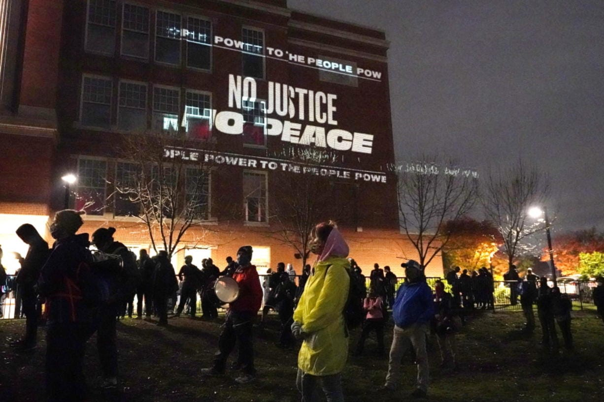 People prepare to march on the night of the election, Tuesday, Nov. 3, 2020, in Portland, Ore.