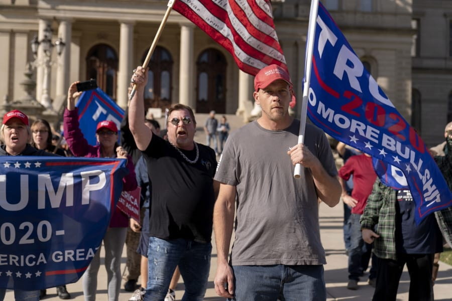 Trump supporters demonstrating the election results face off with counter protesters at the State Capitol in Lansing, Mich., Saturday, Nov. 7, 2020. Democrat Joe Biden defeated President Donald Trump to become the 46th president of the United States on Saturday, positioning himself to lead a nation gripped by the historic pandemic and a confluence of economic and social turmoil.