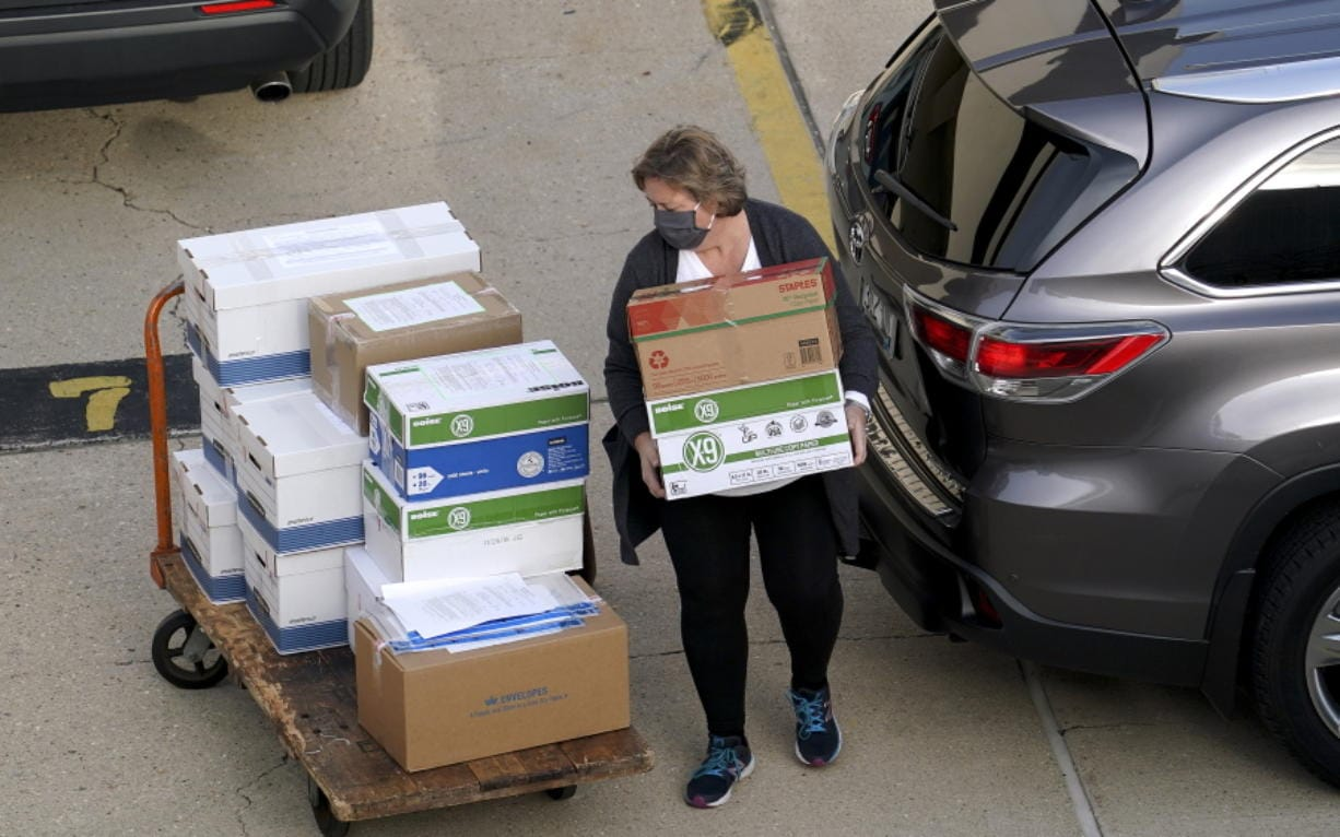Election officials from around Dane County bring ballots in, Thursday, Nov., 19, 2020 to the Monona Terrace in Madison, Wis. for the recount that begins Friday.