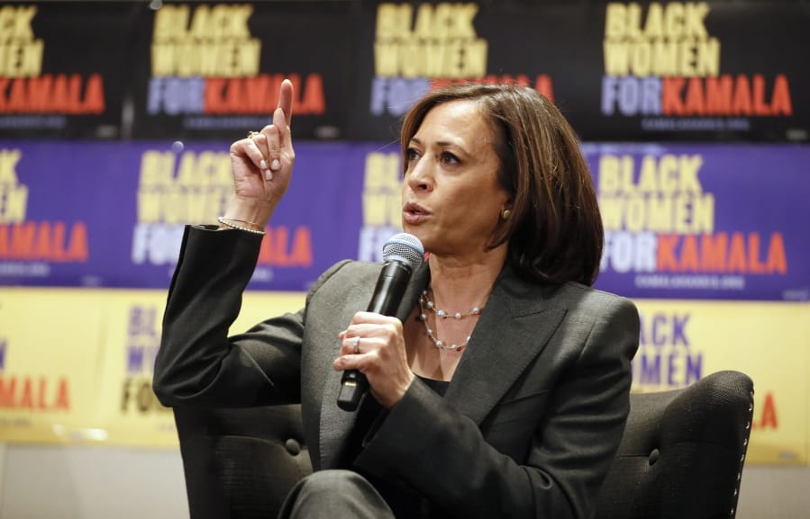 FILE - Sen. Kamala Harris, D-Calif., speaks at a Black Women's Power Breakfast co-hosted by Higher Heights and The Collective PAC at the Westin in Atlanta, in this Nov. 21, 2019, file photo. Women's advocates are celebrating the ascension of Harris to the second highest office in the land.