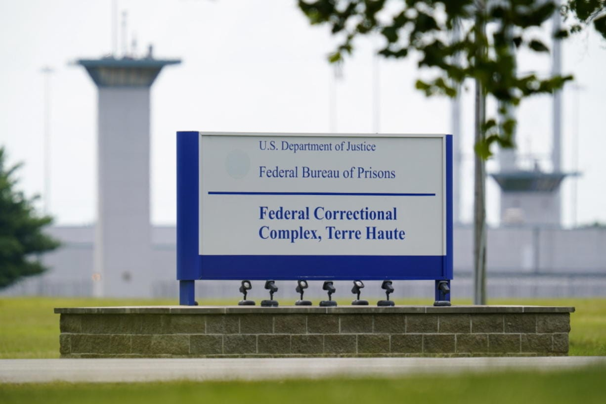 FILE - This Aug. 28, 2020, file photo shows the federal prison complex in Terre Haute, Ind. The Justice Department has scheduled three more federal executions during the lame-duck period before President-elect Joe Biden takes office, including two just days before his inauguration. In a court filing Friday night, Nov. 20, 2020 the Justice Department said it was scheduling the executions of Alfred Bourgeois for Dec. 11 and Cory Johnson and Dustin Higgs for Jan. 14 and 15.