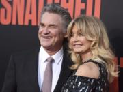 "FILE - Kurt Russell, left, and Goldie Hawn appear at the premiere of Hawn's film, ""Snatched"" in Los Angeles on May 10, 2017. Russell and Hawn star in the holiday film ""The Christmas Chronicles: Part Two,"" premiering Friday on Netflix."
