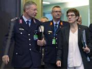 FILE - In this Thursday, Oct. 24, 2019 file photo German Defense Minister Annegret Kramp Karrenbauer, front right, arrives for a meeting of NATO defense ministers at NATO headquarters in Brussels, Belgium. Germany's defense minister on Tuesday rejected Turkish complaints over the search of a Turkish freighter in the Mediterranean Sea by a German frigate participating in a European mission, insisting that German sailors behaved correctly.