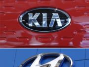 FILE- This combination of file photos shows the logo of Kia Motors during an unveiling ceremony on Dec. 13, 2017, in Seoul, South Korea, top, and Hyundai logo on the side of a showroom on April 15, 2018, in the south Denver suburb of Littleton, Colo., bottom.  Hyundai and Kia will spend $137 million on fines and safety improvements because they moved too slowly to recall over 1 million U.S. vehicles with engines that can fail. The National Highway Traffic Safety Administration announced the penalties Friday, Nov. 27, 2020.