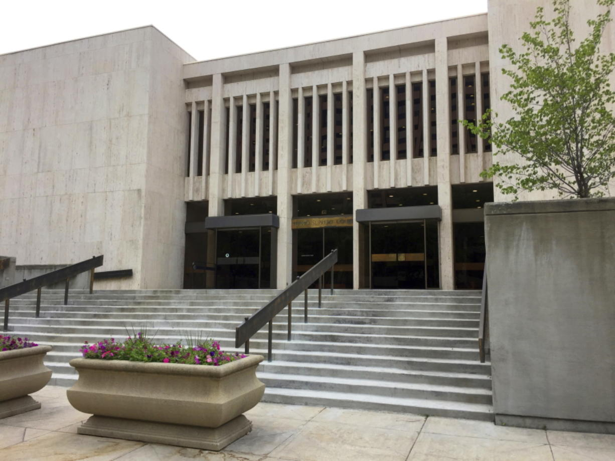 FILE - This June 8, 2017 file photo shows the Idaho Supreme Court building in Boise, Idaho. The Idaho Supreme Court says state prison officials must turn over records that include information about where they obtained lethal injection drugs used in recent executions. The high court's ruling on Friday, Nov. 20, 2020, was a win for University of Idaho Professor Aliza Cover, who studies how the public interacts with the death penalty.