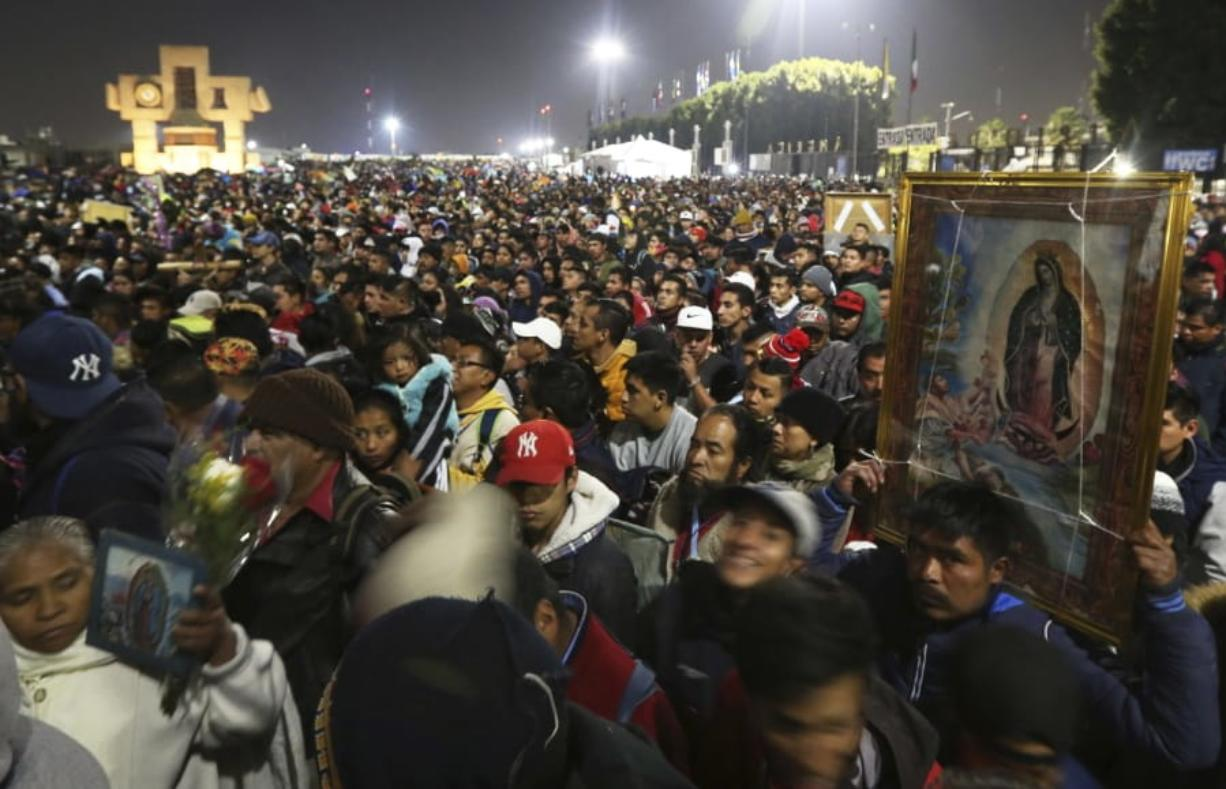Pilgrims arrive Dec. 12 at the plaza outside the Basilica of Our Lady of Guadalupe in Mexico City. Due to the COVID-19 pandemic, the Mexican Catholic Church announced on Monday the cancellation of the annual pilgrimage, the largest Catholic pilgrimage worldwide.