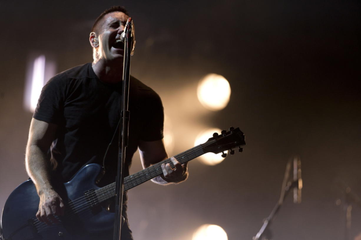 Trent Reznor of Nine Inch Nails performs in 2014 at the Vive Latino music festival in Mexico City, Mexico. The band was be inducted into the Rock and Roll Hall of Fame on Saturday.