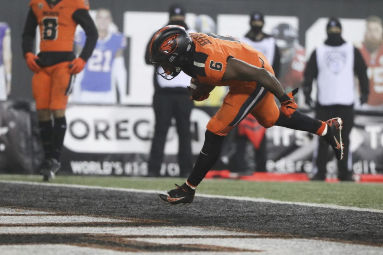 Oregon State running back Jermar Jefferson scores a touchdown during the second half of an NCAA college football game against Oregon in Corvallis, Ore., Friday, Nov. 27, 2020. Oregon State won 41-38.