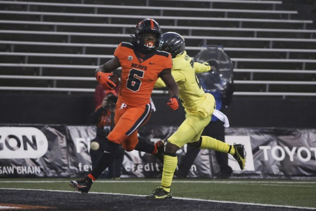 Oregon State running back Jermar Jefferson (6) runs past Oregon cornerback Mykael Wright (2) and into the end zone for a first-quarter touchdown on Friday. Jefferson finished with 226 yards rushing on 29 carries and two touchdowns.