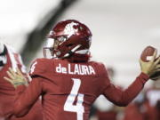 Washington State quarterback Jayden de Laura (4) throws a pass during the first half of the team's NCAA college football game against Oregon in Pullman, Wash., Saturday, Nov. 14, 2020.