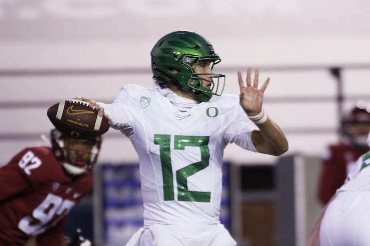 Oregon quarterback Tyler Shough (12) prepares to throw a pass during the first half of the team's NCAA college football game against Washington State in Pullman, Wash., Saturday, Nov. 14, 2020.