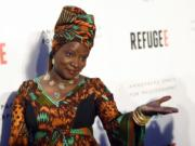 """FILE - In this Thursday, April 21, 2016, file photo, singer and UNICEF Goodwill Ambassador Angelique Kidjo poses at the opening of the new photography exhibit """"REFUGEE"""" at The Annenberg Space for Photography in Los Angeles. Kidjo uses her artistry and her activism to connect beyond language and skin color. Kidjo and other international musicians are performing social justice anthems for an online fundraising concert called Peace Through Music: A Global Event for Social Justice."""